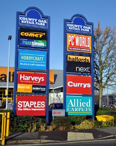 Signs at entrance to County Oak Retail Park, Crawley